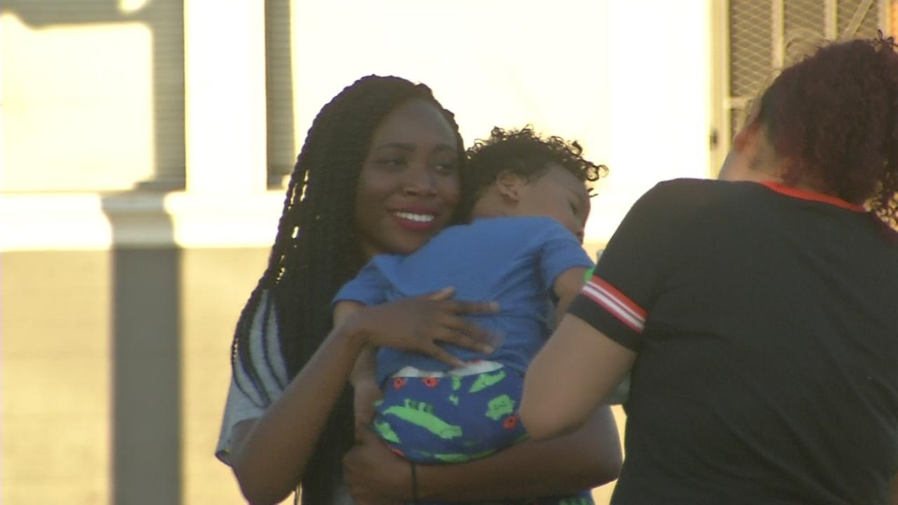A child is reunited with his mother in San Francisco on Saturday, May 20, 2017 after an Amber Alert led to a SoCal search.