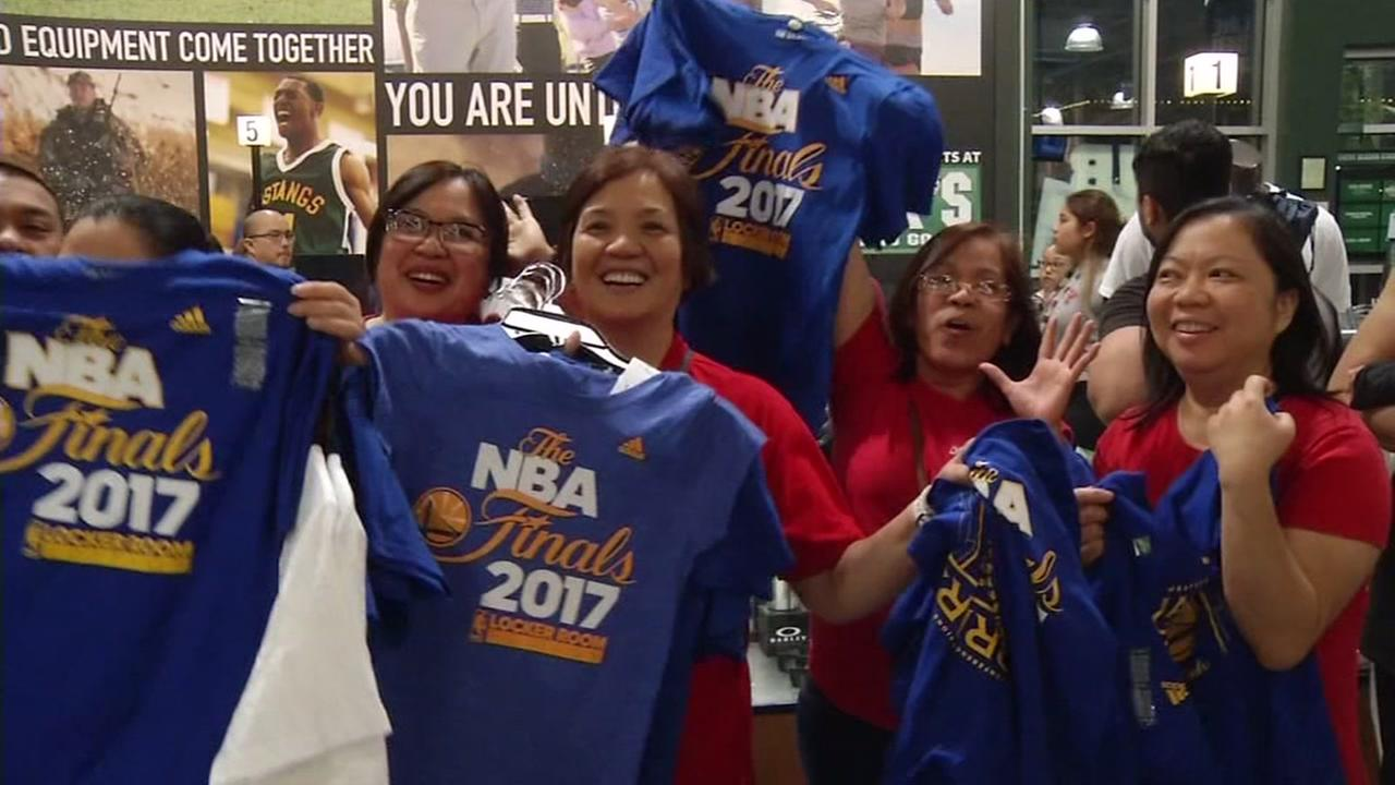 Golden State Warrior fans gather at a Dicks Sporting Goods location in Freemont, Calif. to celebrate the Dubs move to the NBA Finals on Monday, May 22, 2017.