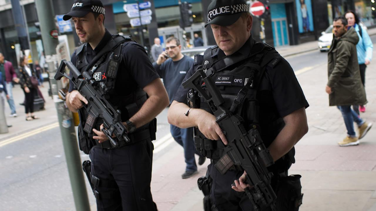 Police officers patrol in central Manchester, Britain, Wednesday, May 24, 2017 after Mondays suicide attack at an Ariana Grande concert. (AP Photo/Emilio Morenatti)