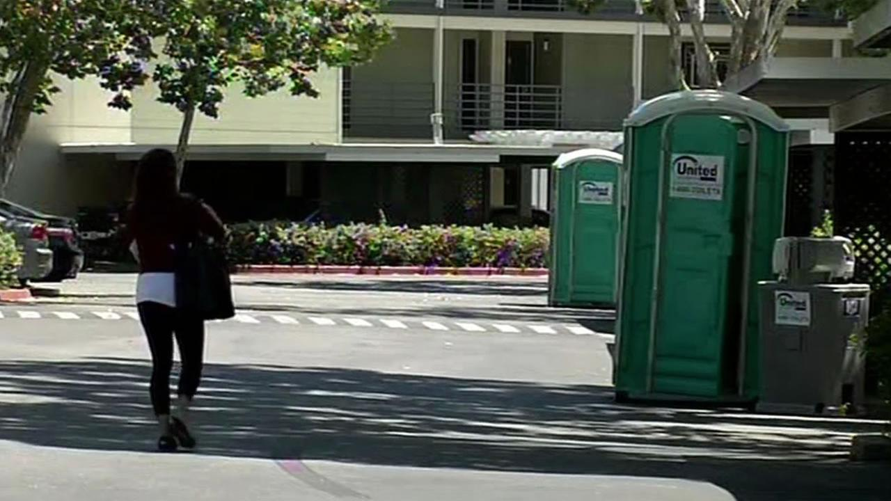 port-o-potties installed outside Pleasanton apartment complex
