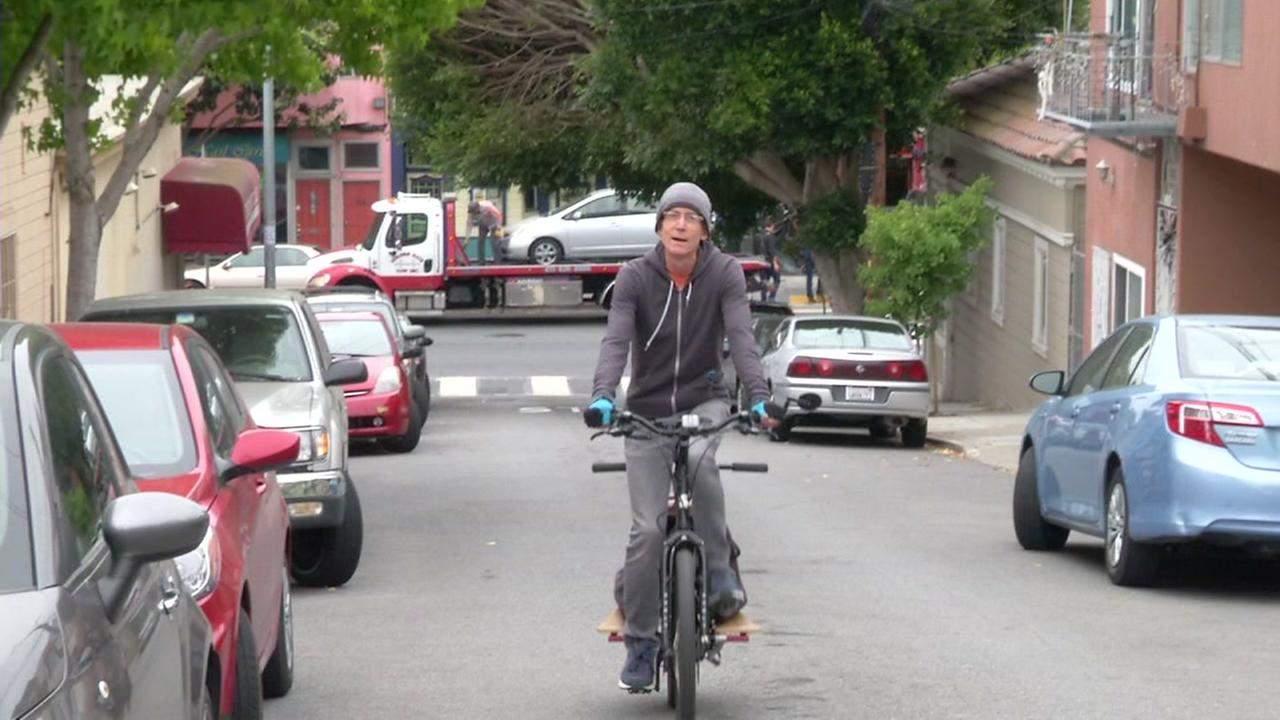 A man is seen riding on an electric hybrid bicycle in San Francisco in this undated image.