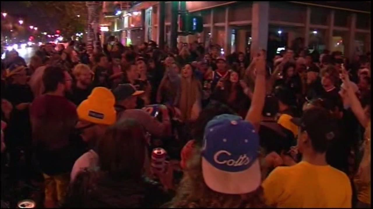 Fans are seen celebrating after the Golden State Warriors won the NBA Finals in this undated image.