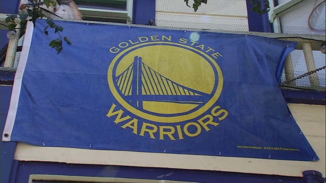 A Golden State Warriors flag is seen hanging in San Francisco on Monday, June 12, 2017.