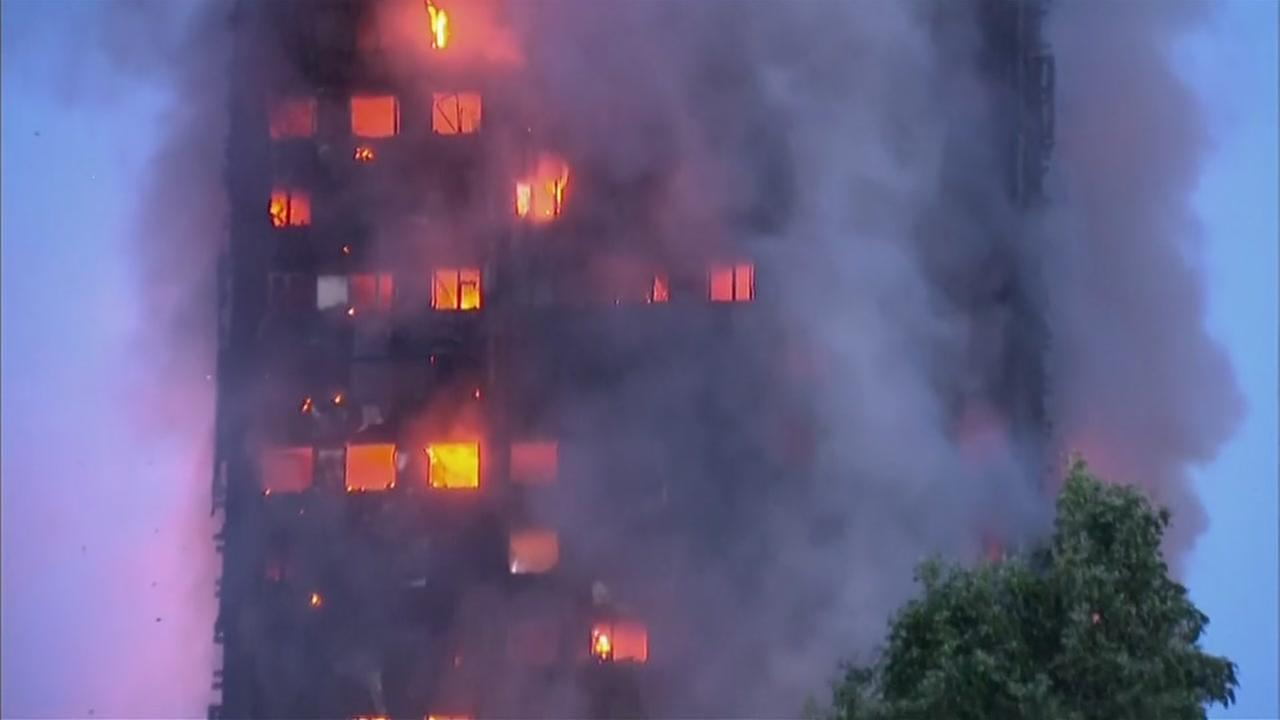 Smoke and fire shoots out of the Greenfell Tower apartment building in London early Wednesday morning on June 13, 2017.