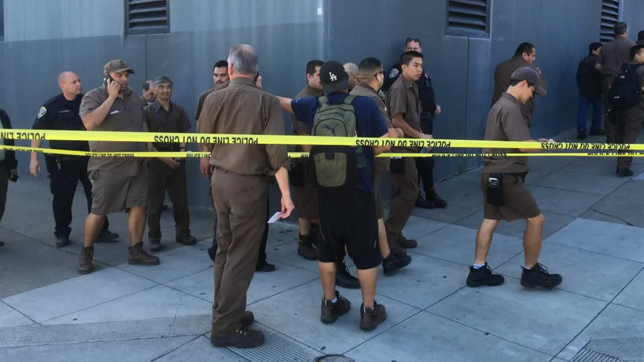 UPS workers gather outside after a reported shooting at a UPS warehouse and customer service center in San Francisco on Wednesday, June 14, 2017.