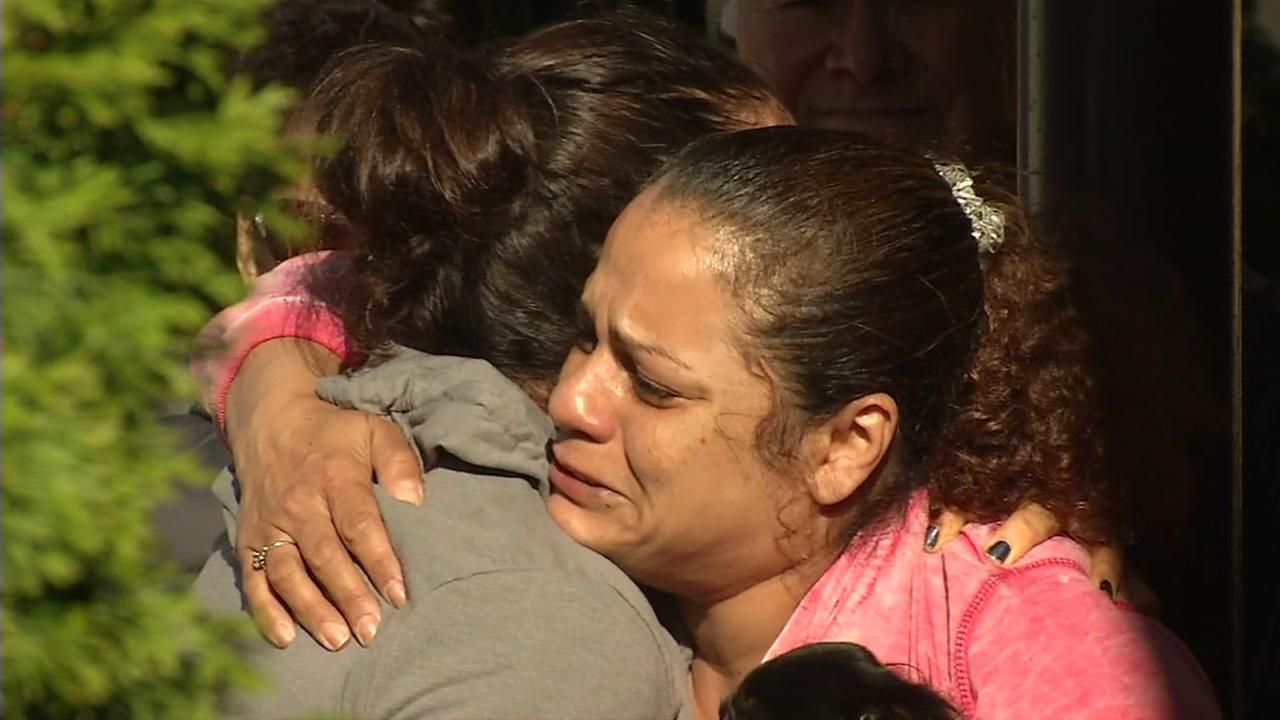 Two mourners hug at the scene of the UPS shooting in San Francisco on Wednesday, June 14, 2017.