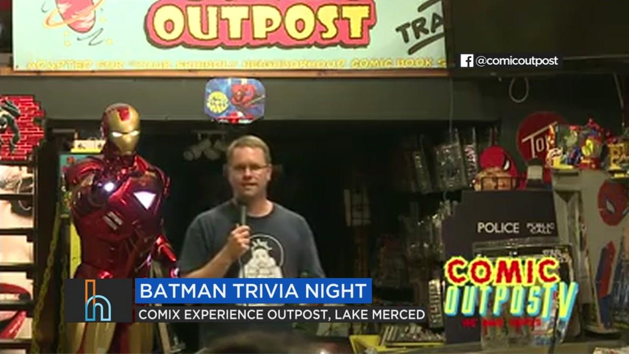 A man is seen hosting a Batman trivia night in San Francisco in this undated image.