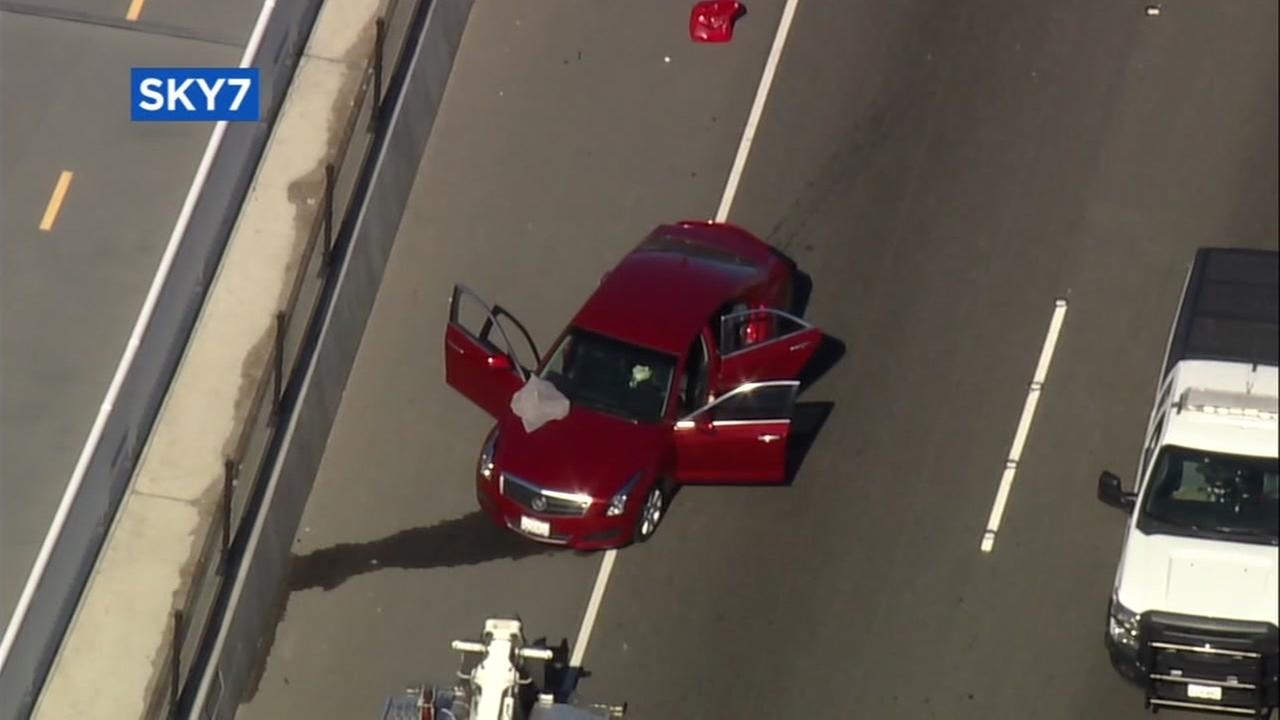 A red Cadillac is seen on the Oakland-San Francisco Bay Bridge after an officer-involved shooting on Sunday, June 18, 2017.