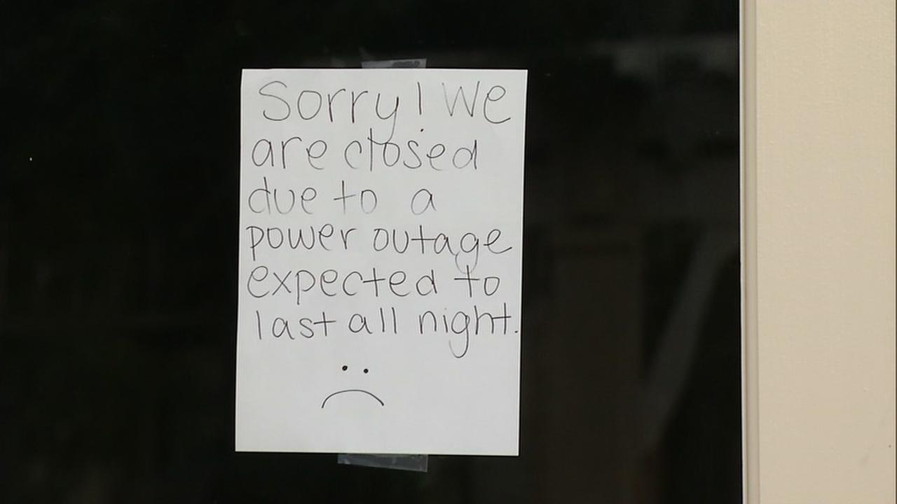 A sign alerting customers to a power outage is seen on a Livermore, Calif. restaurants window on Sunday, June 18, 2017.