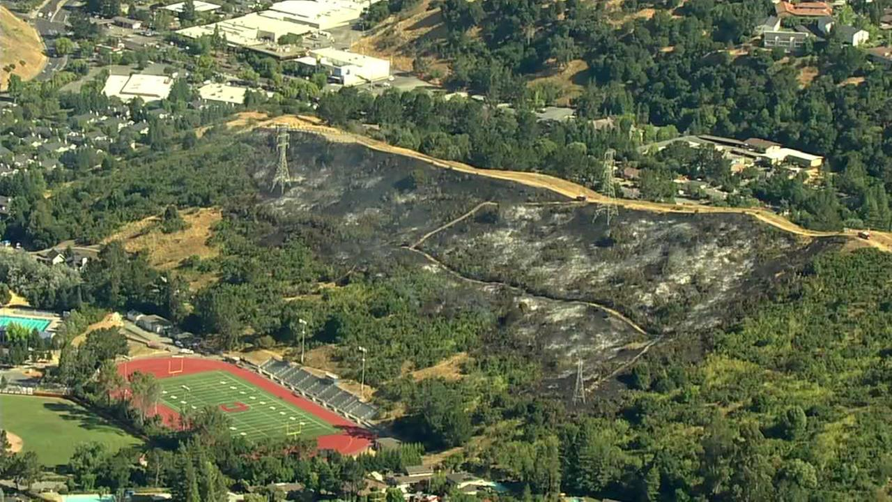 Sky7 was over an area of grass burned by a fire near Campolindo High School in Moraga, Calif. on Monday, June 19, 2017.