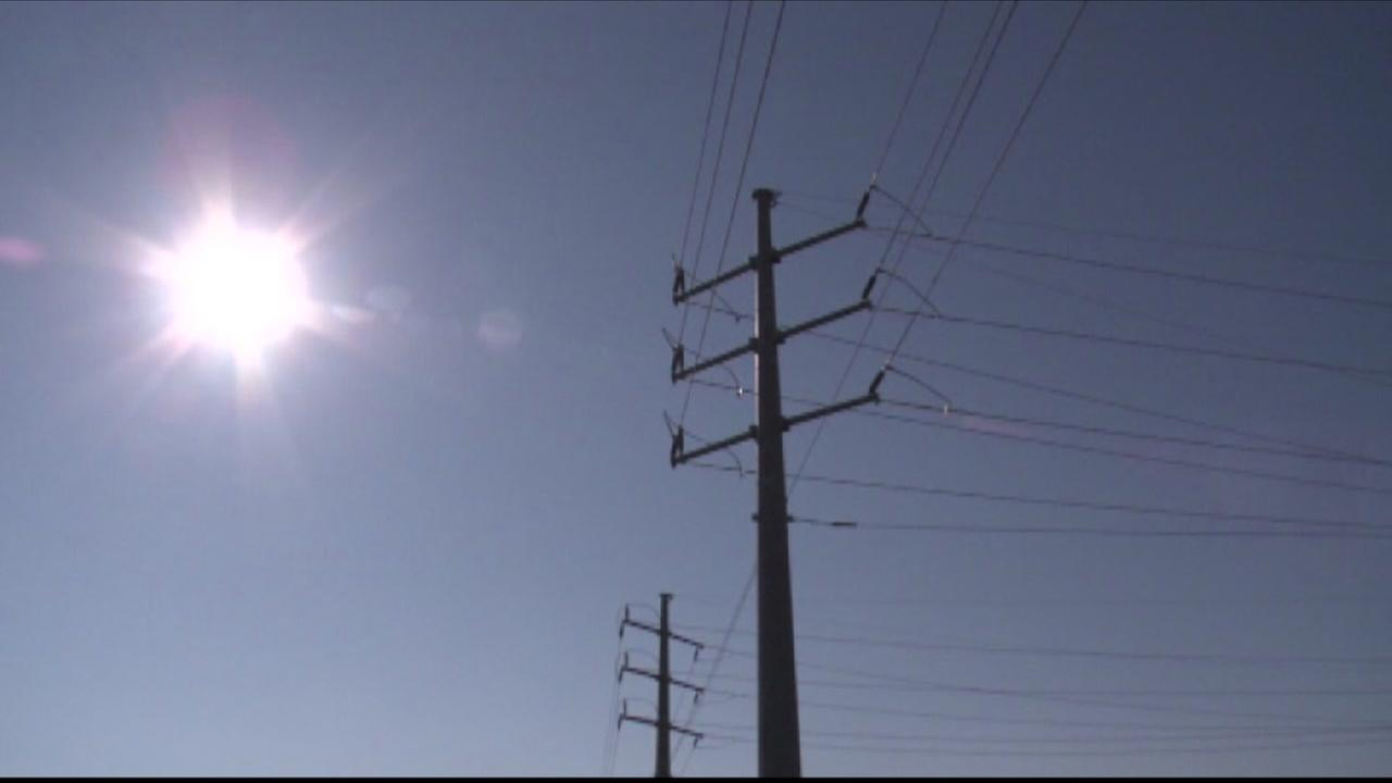 The sun is seen shining above a power pole in this undated image.