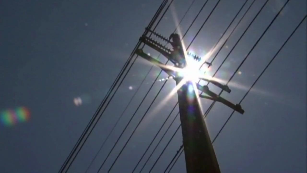 The sun is seen above a power pole in this undated image.