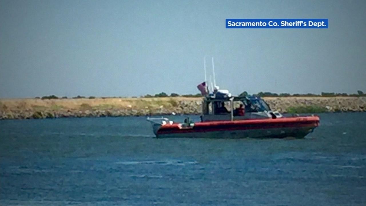 A Coast Guard boat is seen on the Sacramento River in Rio Vista, Calif. on Sunday, June 25, 2017.