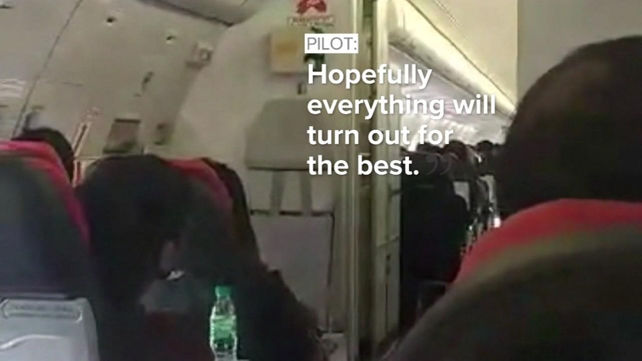A passenger shot video while a plane shook violently during an AirAsia flight from Australia.