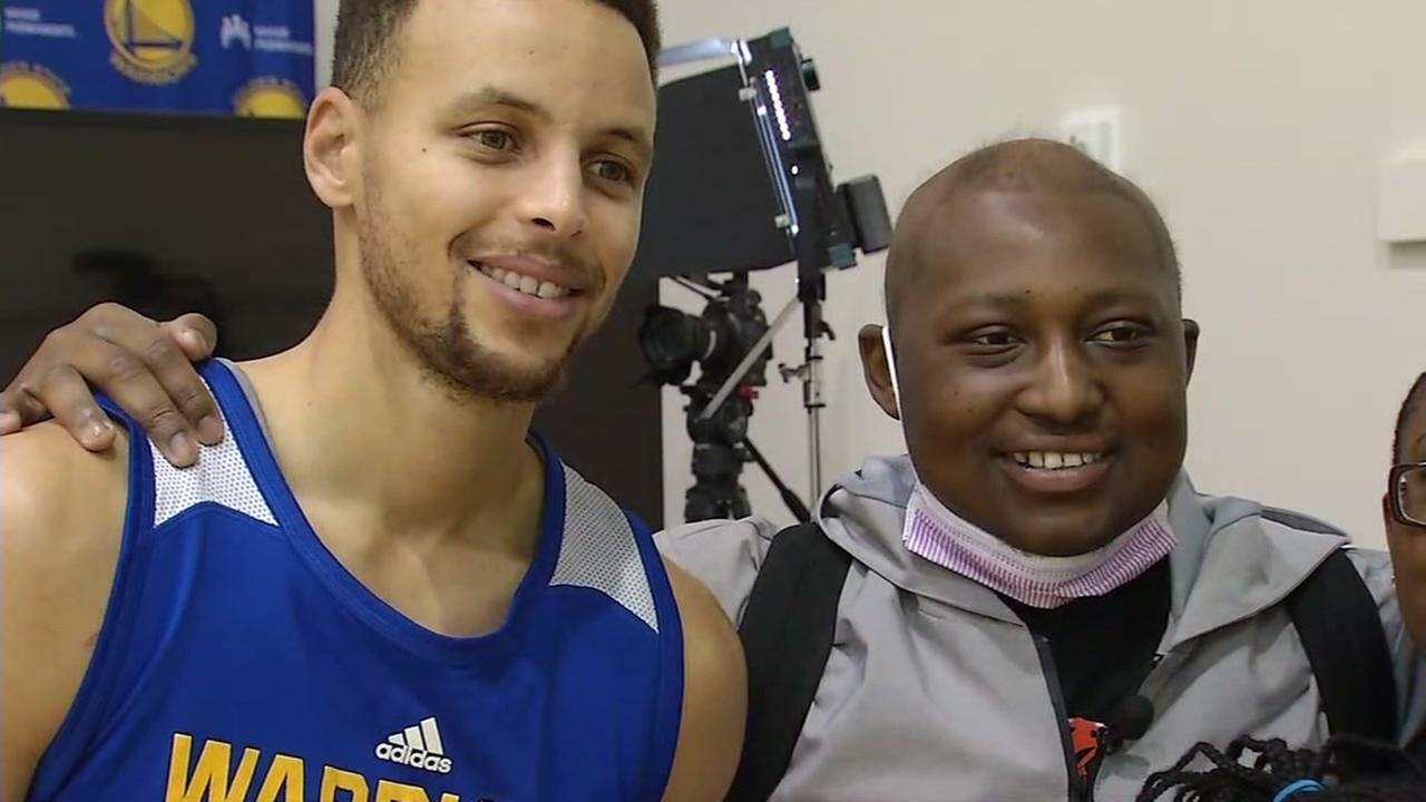 FILE -- Golden State Warriors Stephen Curry and Darryl Aikens, December 2016.