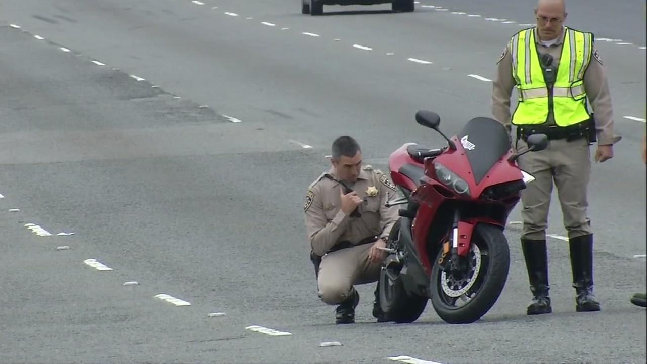 A CHP officer is seen inspecting a motorcycle after a fatal crash in San Pablo, Calif. on Monday, July 3, 2017.