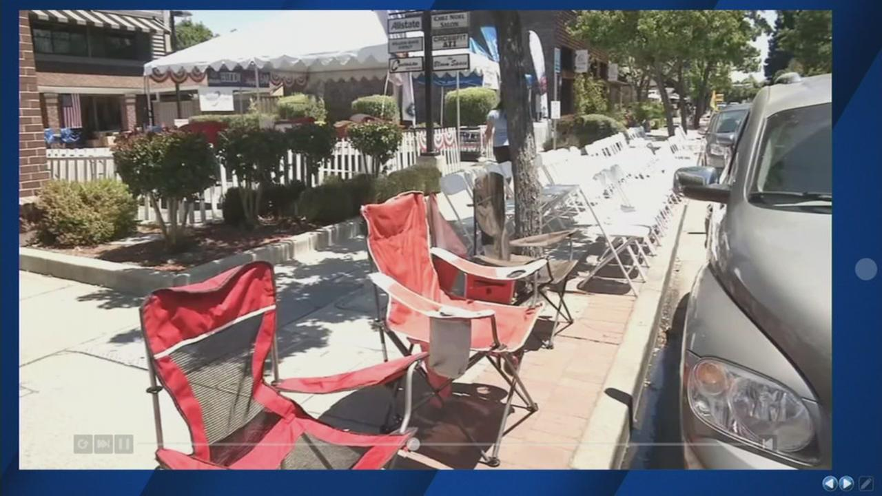 Chairs appear to save spots before a 4th of July celebration in Morgan Hill, Calif. on Monday, July 3, 2017.