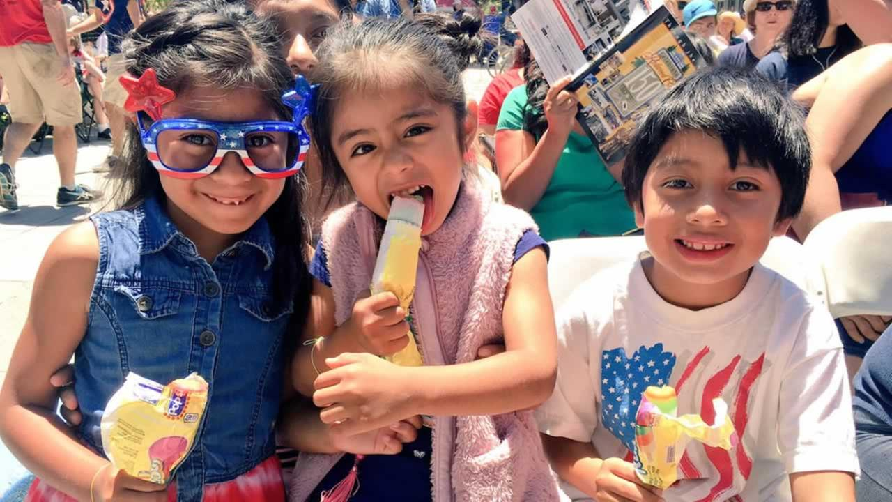 Kids have fun while watching the 4th of July parade in Redwood City, Calif. on Tuesday, July 4, 2017.