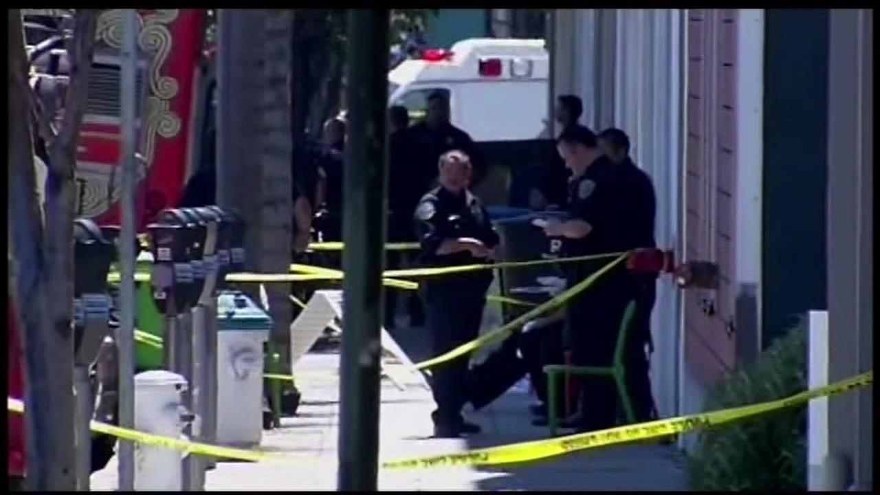Police are seen after a double homicide inside a jewelry mart in San Francisco on July 12, 2013.