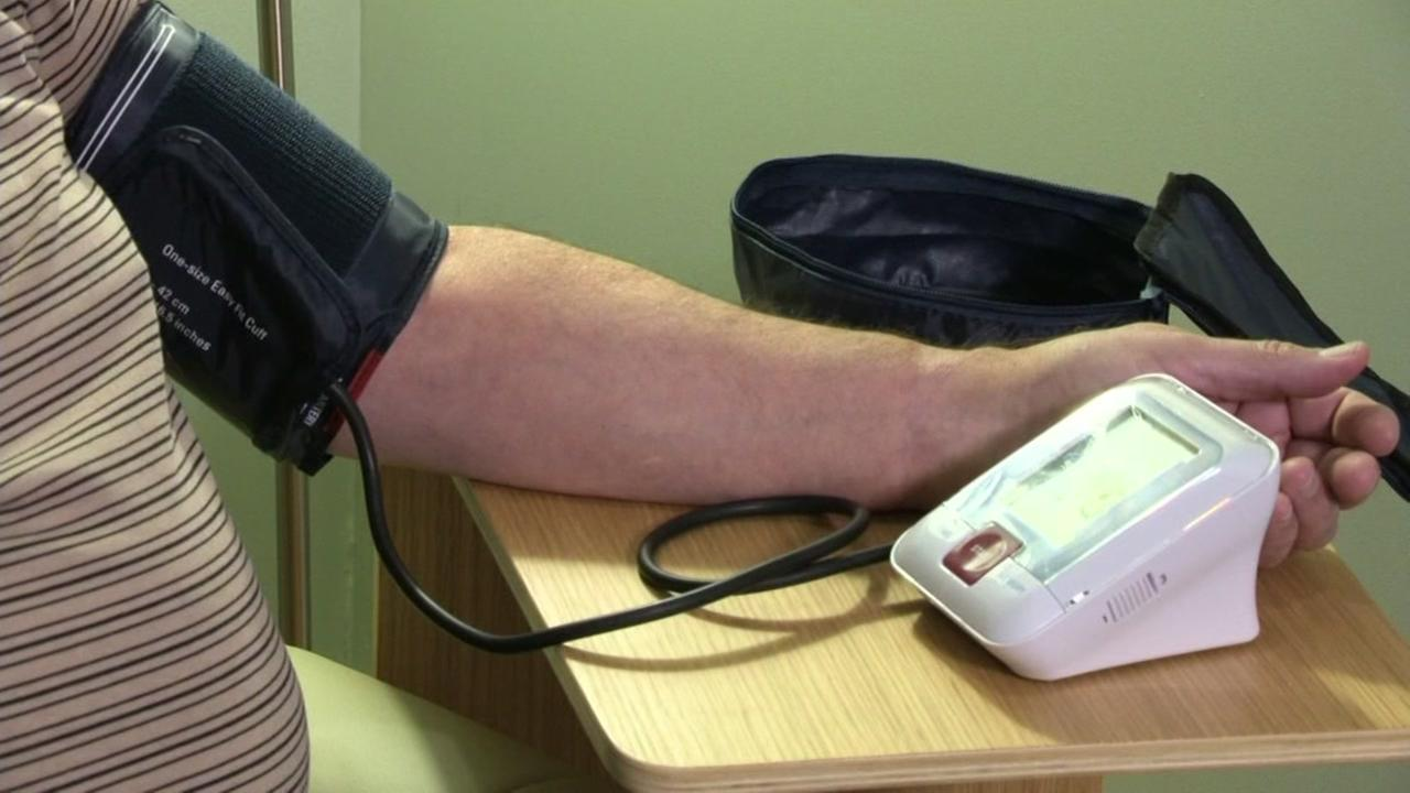 A patients blood pressure is checked in a doctors office in this undated image.