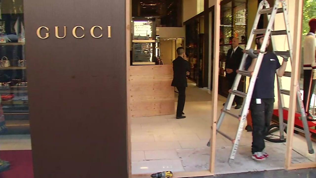 Crews work to repair damaged windows at a Gucci store in San Francisco on Saturday, July 15, 2017.