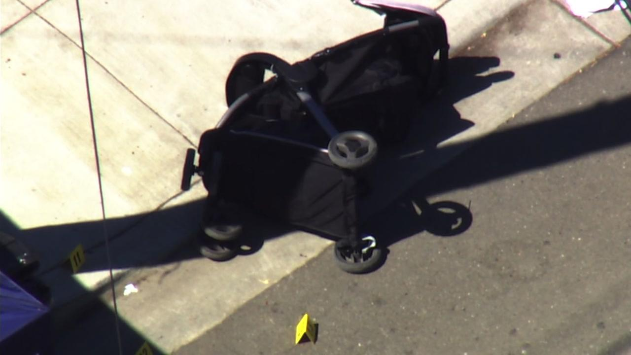 A stroller appears tipped over near Hayward, Calif. after a fatal shooting on Wednesday, July 19, 2017.