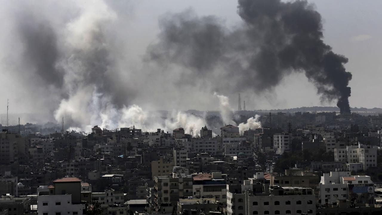 Smoke from Israeli strikes rise over Gaza City, in the northern Gaza Strip, Sunday, July 27, 2014.(AP Photo/Adel Hana)