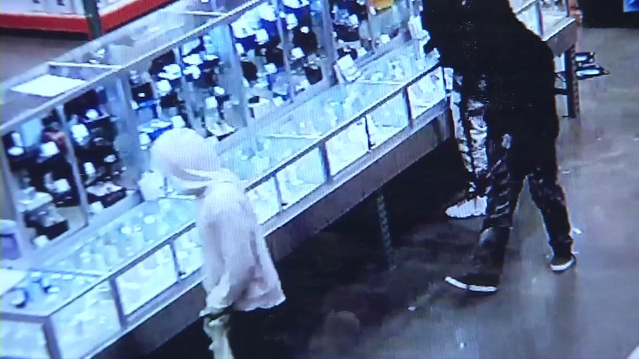 Suspects in a Costco smash and grab robbery appear in this undated surveillance image.