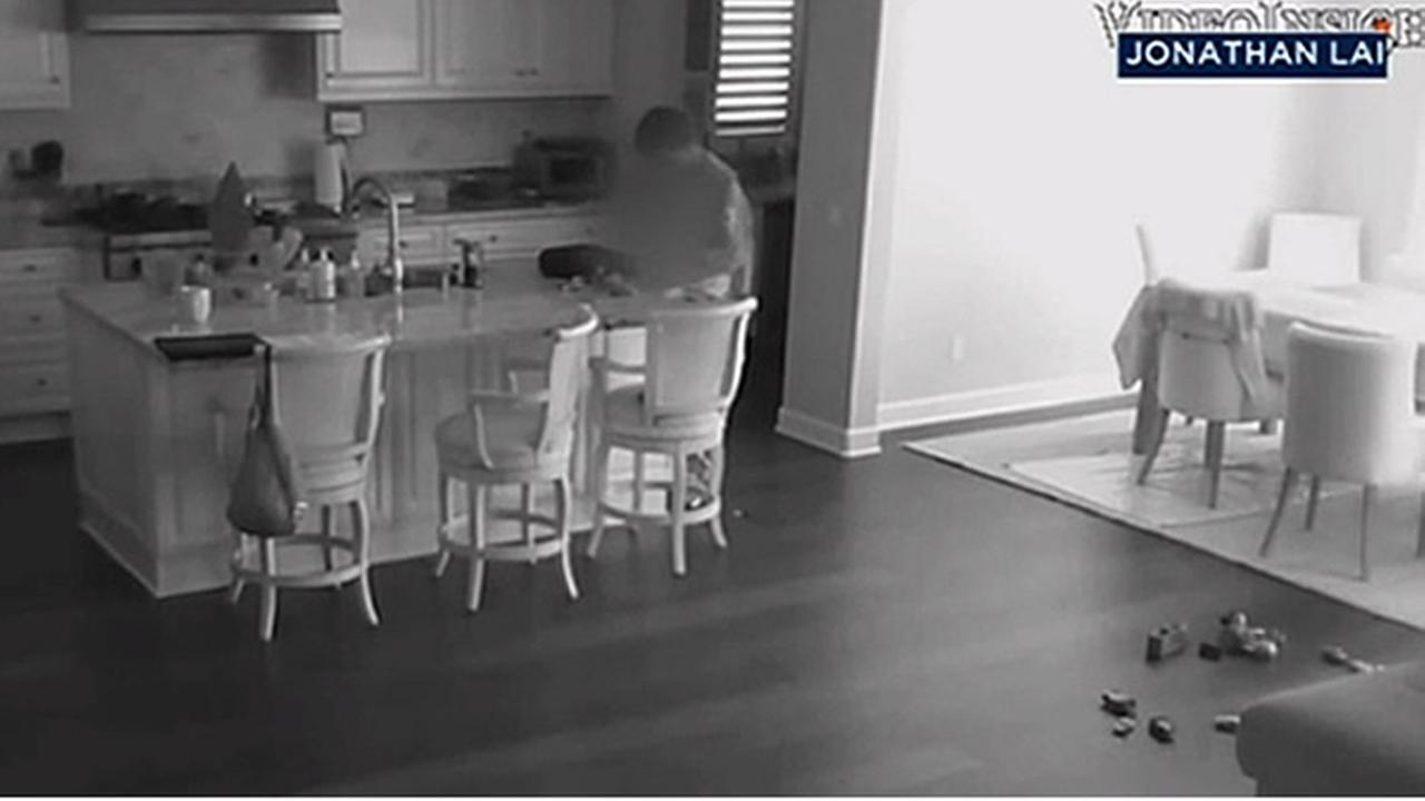 Surveillance video shows a burglary suspect inside a home in Irvine, Calif.