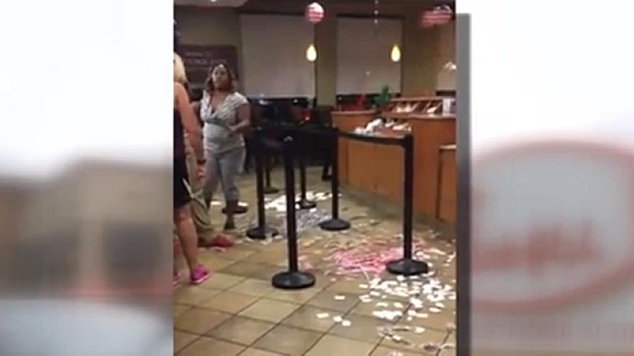 A woman is seen inside a Chick-fil-a restaurant after someone tossed condiments all over the floor on Monday, July 31, 2017.
