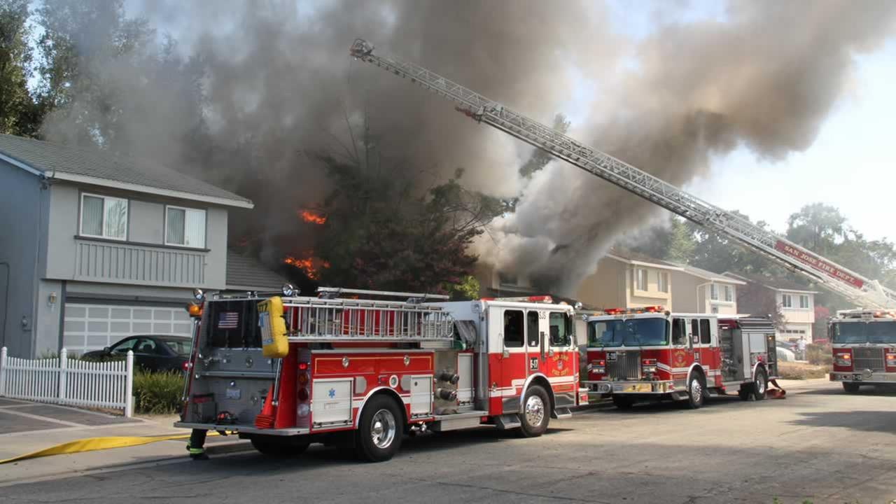 Firefighters this afternoon knocked down a five-alarm fire that destroyed one home and damaged another in San Jose.