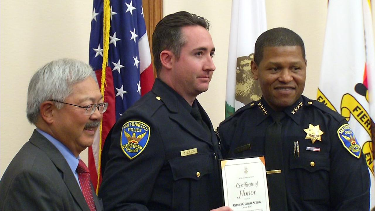 Mayor Ed Lee honors a San Francisco police officer for his heroic work during the San Francisco UPS shooting.
