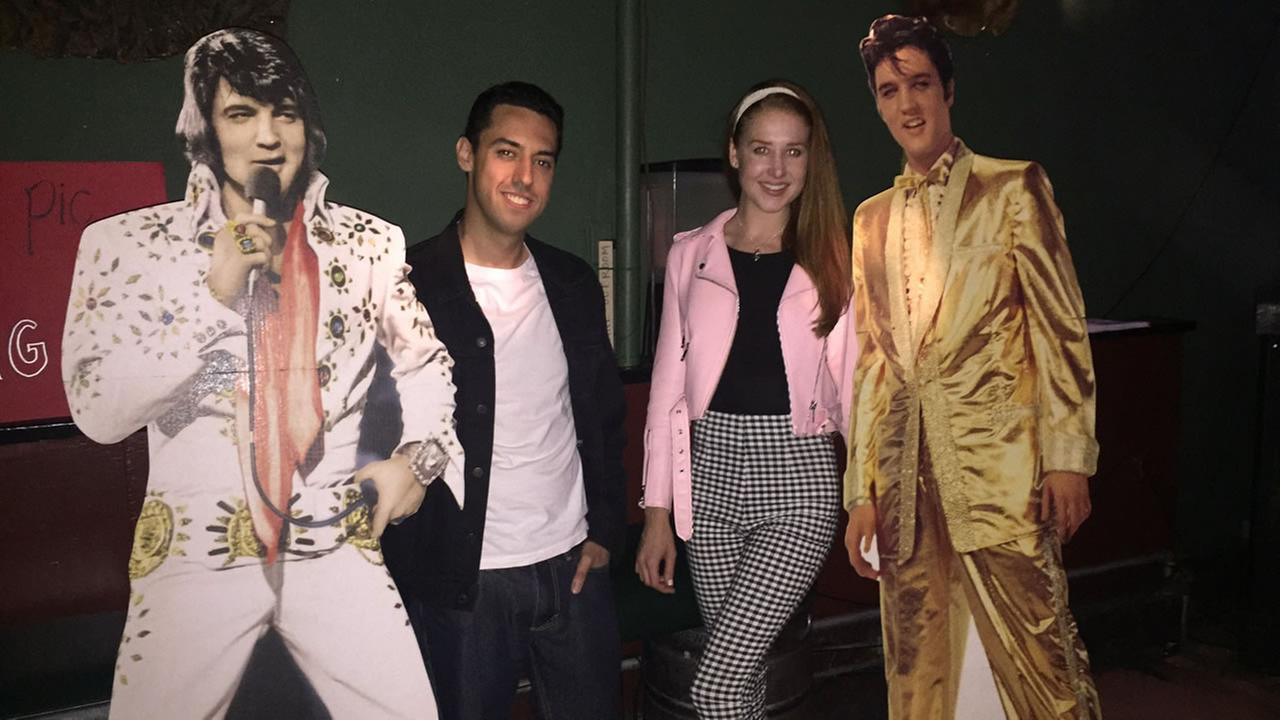 Two fans pose with Elvis cutouts on Wednesday, Aug. 16, 2017.
