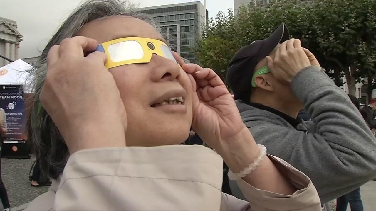 Eclipse watchers are seen in San Francisco on Monday, August 21, 2017.