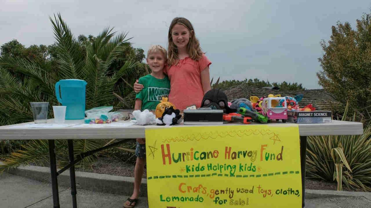 Children are seen at a lemonade stand in Tiburon, Calif. on Monday, September 4, 2017 during a fundraiser for Harvey victims in Texas.