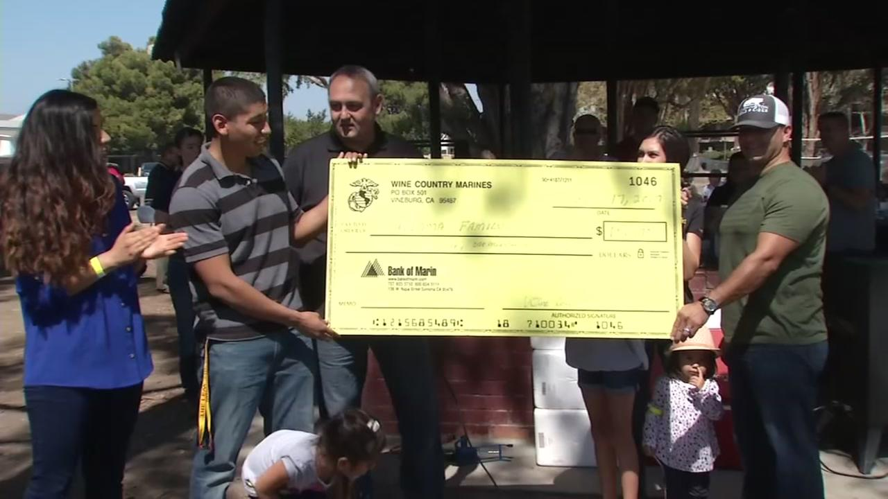 Marines present $10,000 check to comrade whose belongings were stolen in Santa Rosa