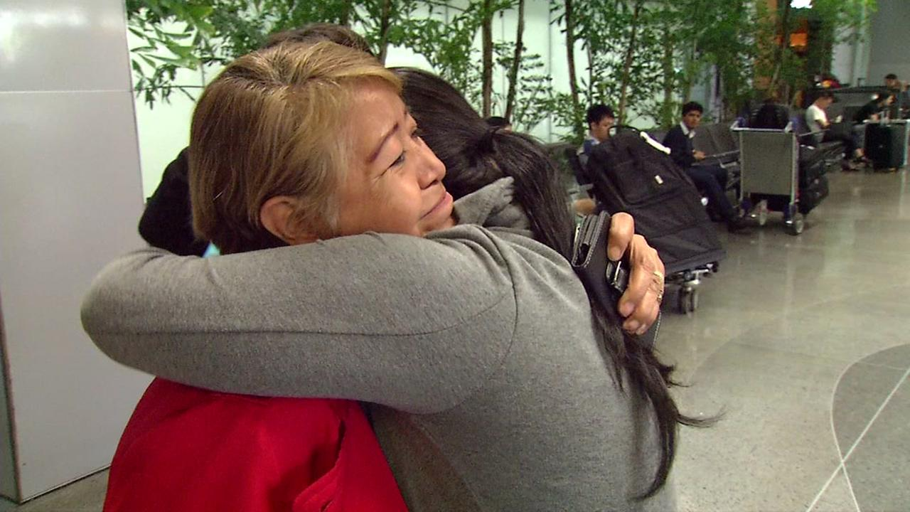 Two earthquake evacuees from Mexico embrace after arriving at San Francisco International Airport on Wednesday, Sept. 20, 2017.