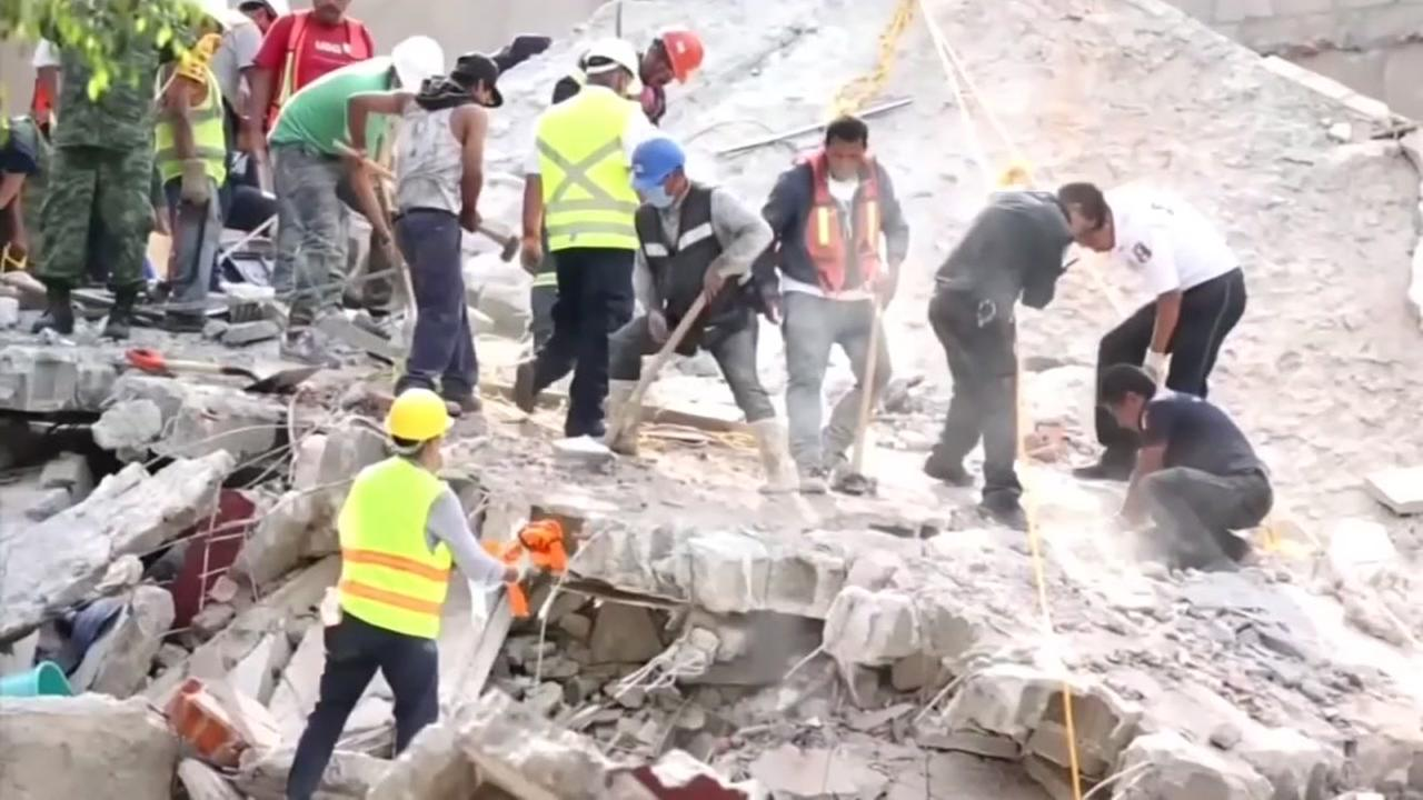 Workers sift through the rubble of a deadly earthquake in Mexico on Wednesday, Sept. 20, 2017.
