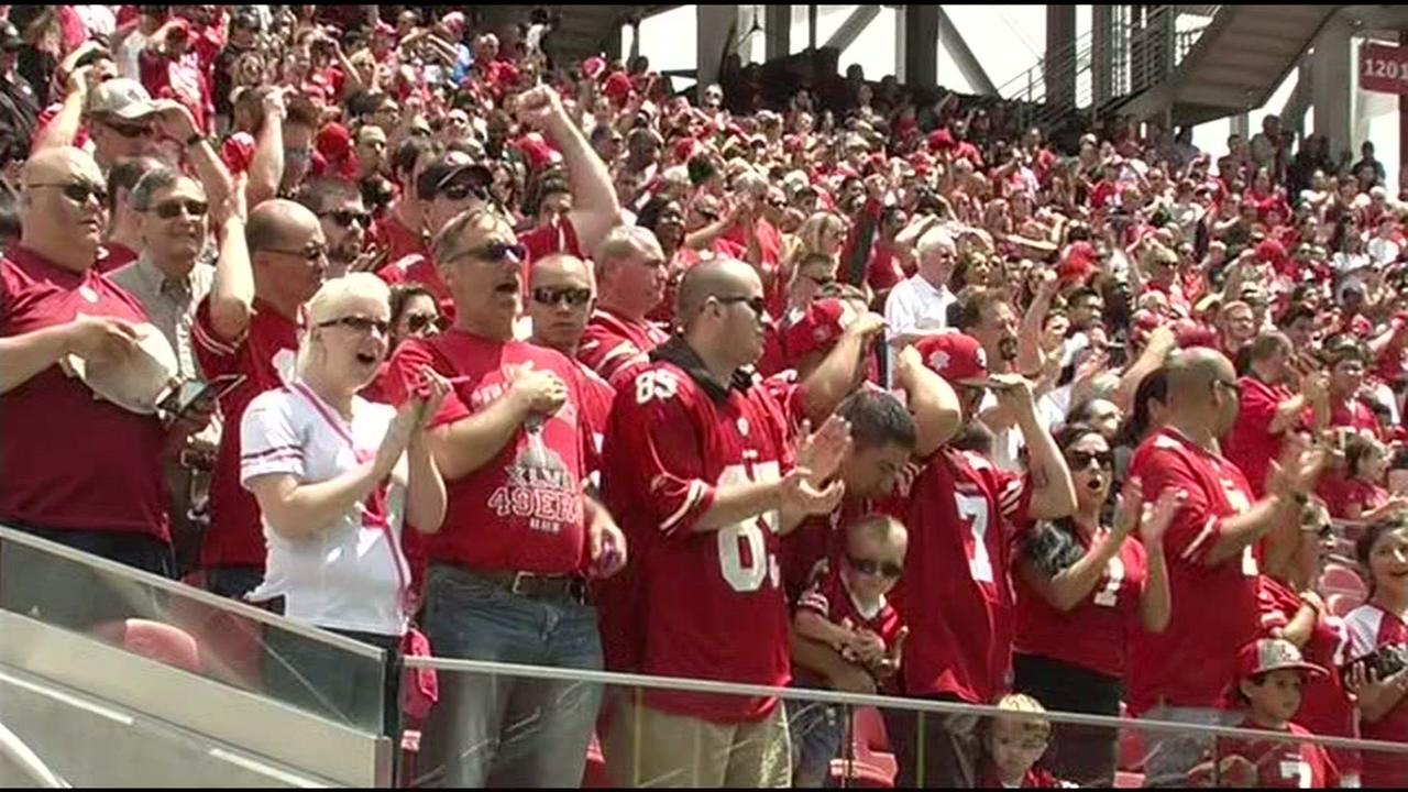 San Francisco 49ers fans are seen cheering at a game in Santa Clara, Calif. in this undated image.