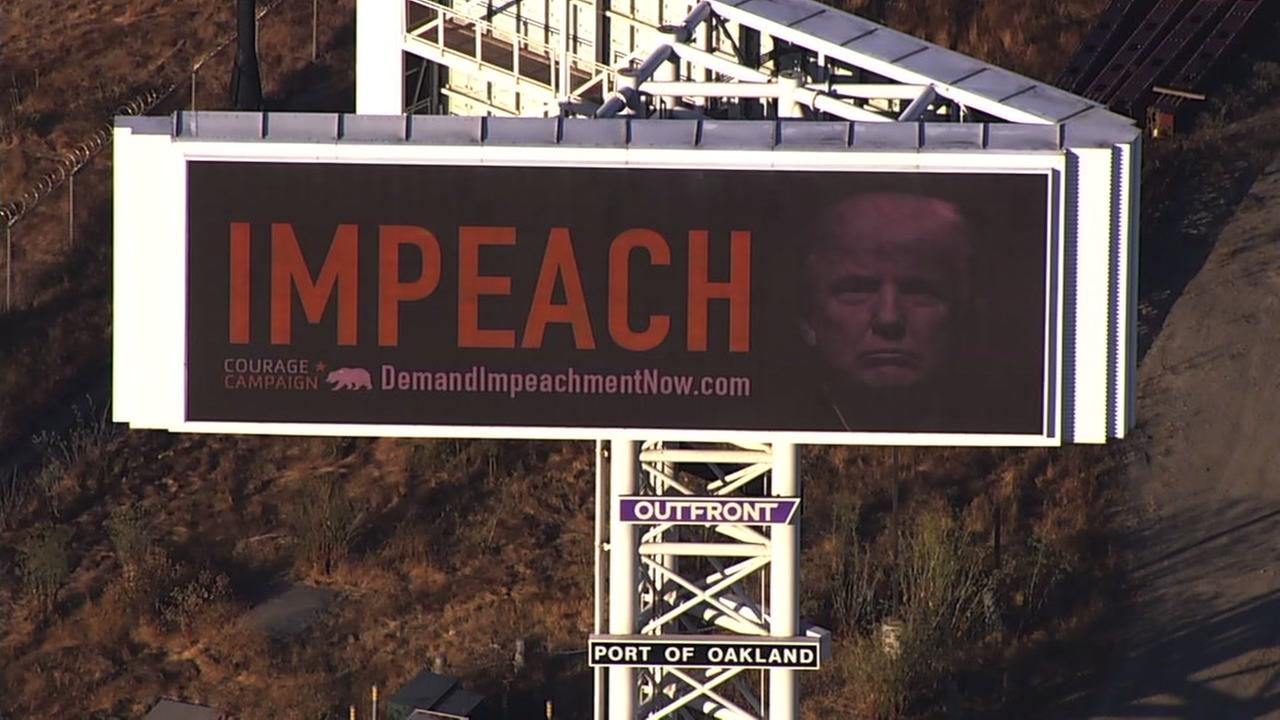 A new billboard thats calling on Congress to impeach President Trump is seen near the Bay Bridge on Monday, September 25, 2017.