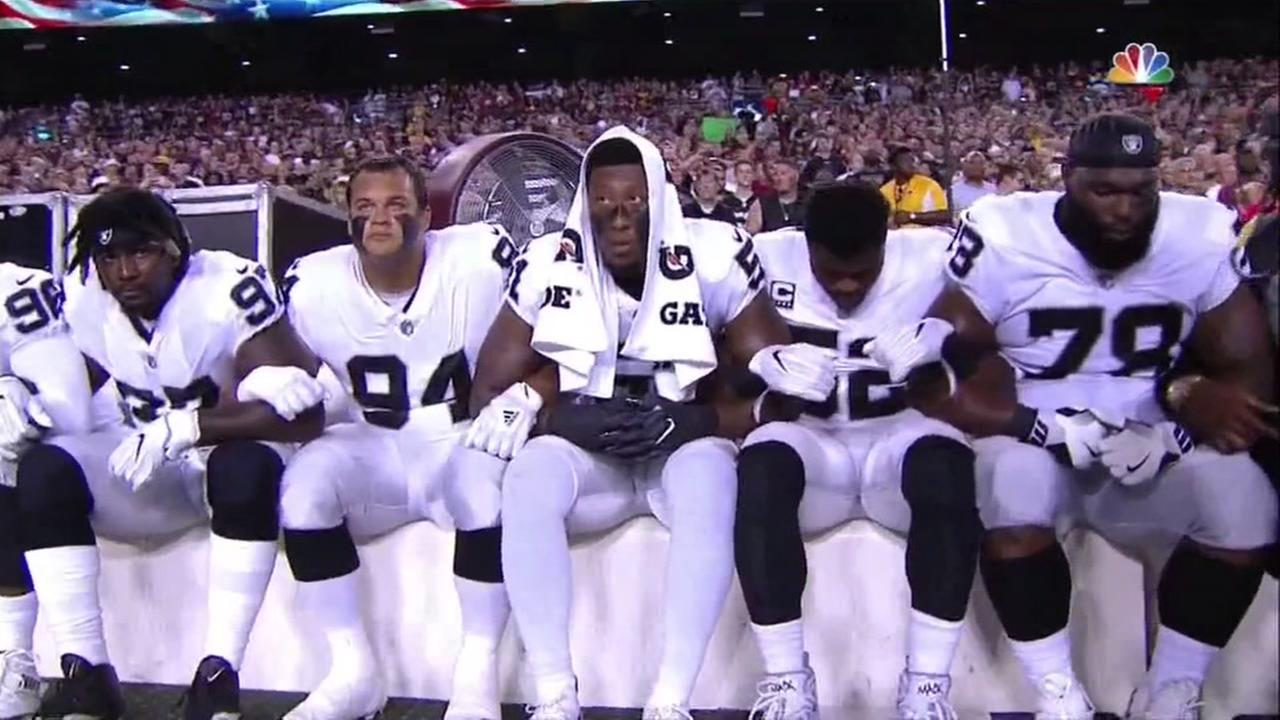 Oakland Raiders players are seen sitting during the national anthem on Sunday, September 24, 2017.