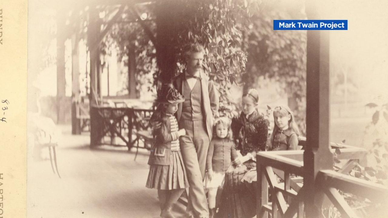 This archival image shows Mark Twain and members of his family.