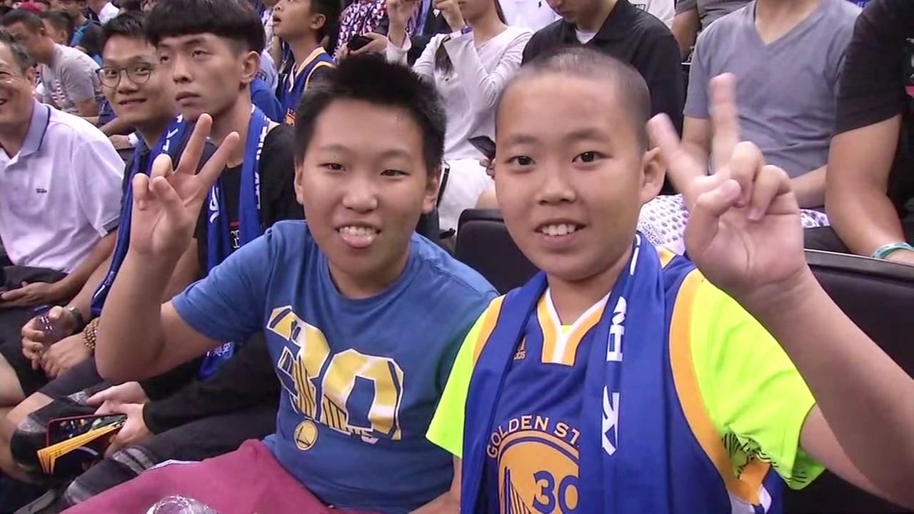 This is an image of Chinese fans watching the Golden State Warriors play in China on Thursday, October 5, 2017.