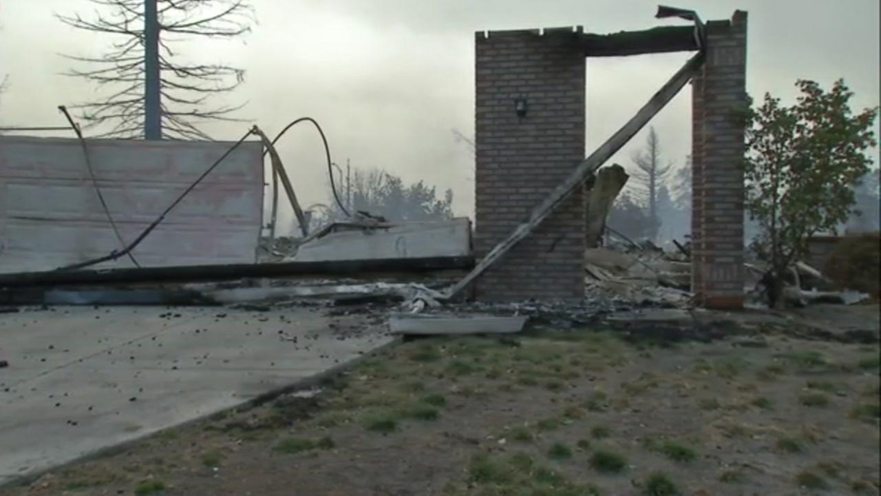 The ruins of a home in Santa Rosa appear during raging wildfires in the North Bay on Monday, Oct. 9, 2017.KGO-TV