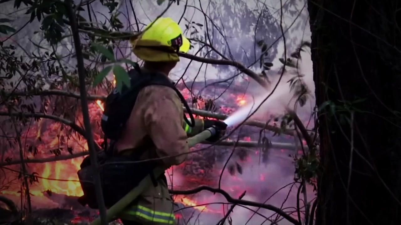 A firefighter is seen battling flames in the North Bay fires in this undated image.