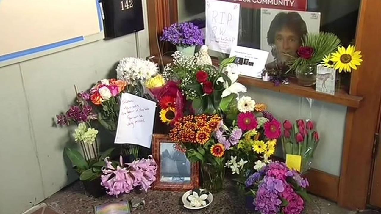 Flowers and candles left outside Throckmorton Theatre