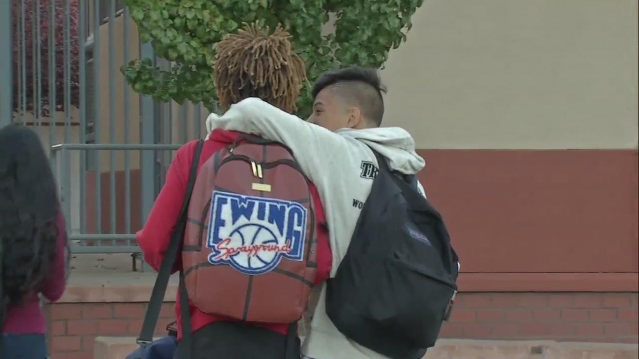 Students hug at a school in Santa Rosa, Calif. on Friday, October 27, 2017.