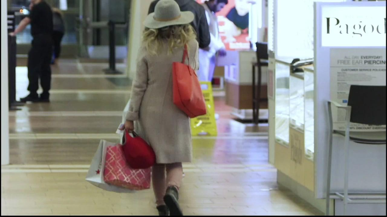 A woman walks in a mall in this undated image.