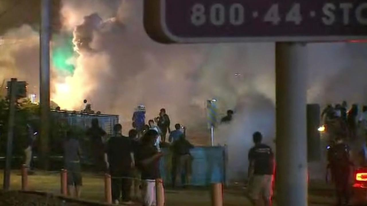 police and protesters clash in Ferguson