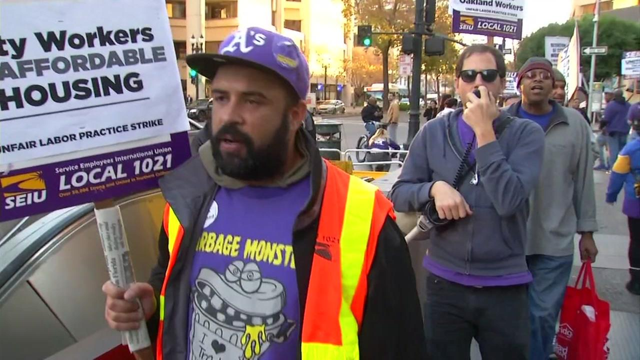 Oakland city workers strike over pay, labor practices in Oakland, Calif. on Tuesday, Dec. 5, 2017.